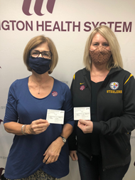 Left: Terry Green, & Right: Susan Vulcano receive their COVID019 vaccines