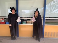 two of our staff members dress as witches to serve lunches